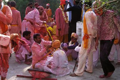 Lath Mar Holi takes place before the actual Holi where men go and play Holi with the women at Barsana near Mathura ,  Uttar Pradesh ,  India