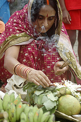 Woman offering prayer during Chhat Puja ,  India