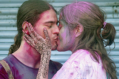 Couple kissing each other during Holi celebrations ,  India