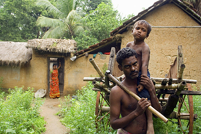 A Santal family in front of their house adjacent to the jungle ,  West Bengal ,  India