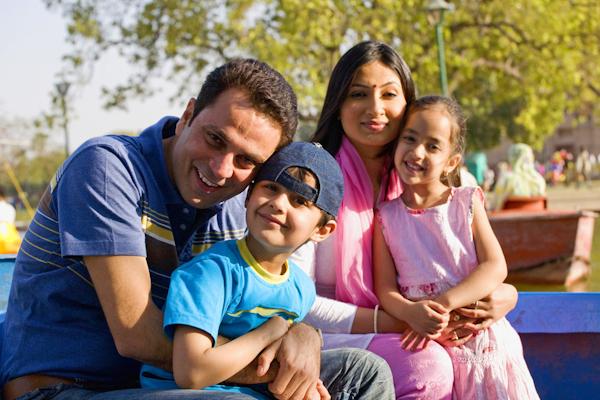 Family on a picnic at India Gate  ,Delhi  ,India
