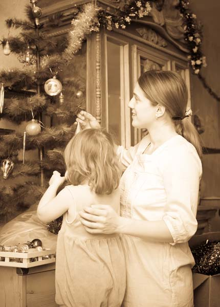 mother and child preparing for Christmas at home. Imitation of an old image