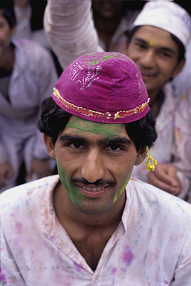 A man celebrating Holi festival. 'Holi' a Hindu spring festival where people spend the day throwing coloured powder and water at each other  ,Delhi  ,India
