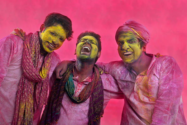 Portrait of Indian men playing holi