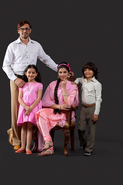 Portrait of Indian young family dressed in retro style
