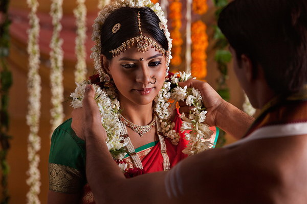 Close-up of Indian couple during wedding ceremony