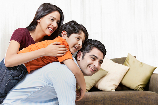Happy Indian family of three playing at home