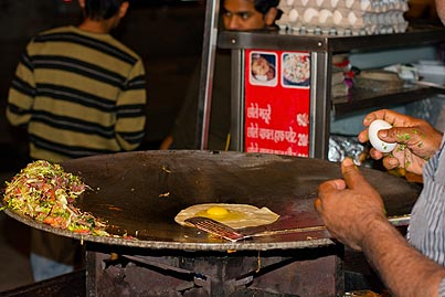 Man making Omelette on a griddle,Indian Street food