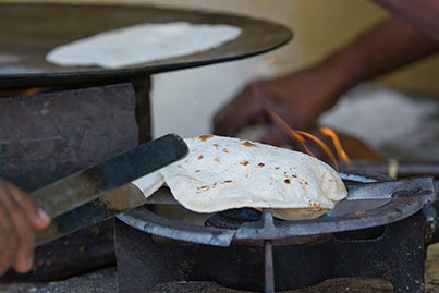 Indian food vendor making chapatti