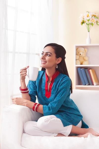 Married Indian Woman Having Coffee In Living Room