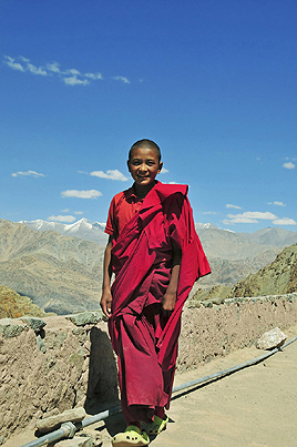 Young Lama on the roof top of the Hemis Monastery ,  Ladakh ,  Jammu and Kashmir ,  India